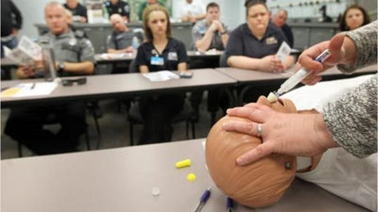 Learning to overpower overdoses-Topsfield EMTs receive naloxone training